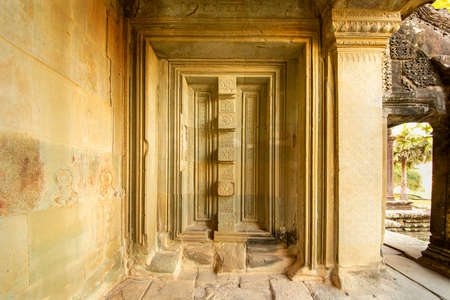 The low relief carvings surrounding Angkor Wat belong to the Khmer Empire. Located in the center of Angkor Thom