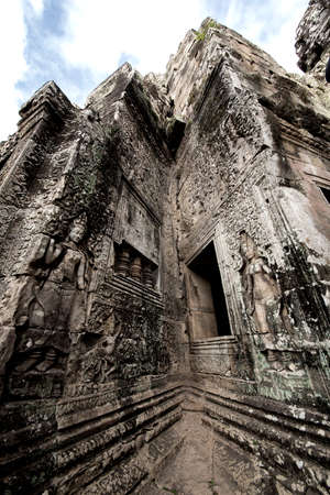 The low relief carvings surrounding Bayon Castle belong to the Khmer Empire. Located in the center of Angkor Thom