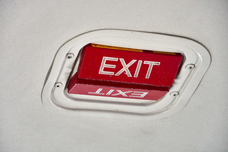 Emergency Exit indicator on cieling of Beechcraft 1900D plane Stock Photo