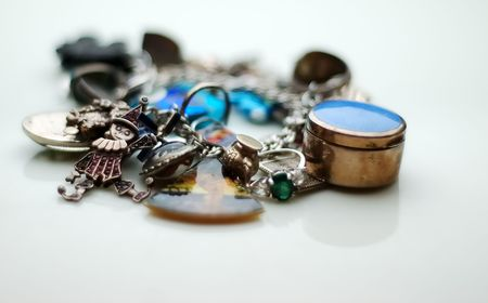 memorabilia: Charm bracelet overloaded with charms.