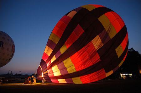 Balloon rising at night. Imagens