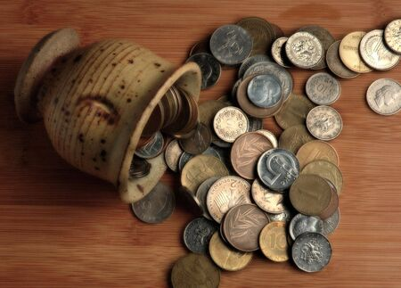 Retired Coins Spilling out of a Cup Banco de Imagens - 489388