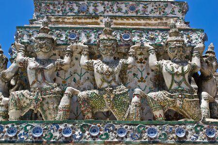 Ancient demon statue in Wat Arun around pagoda, Bangkok, Thailand Stock Photo