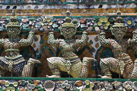 Ancient demon statue in Wat Arun around pagoda, Bangkok, Thailand photo