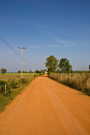 red road in the countryside