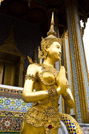The golden Thai fairy bird on half human at Wat Phra Keaw, Thailand Stock Photo