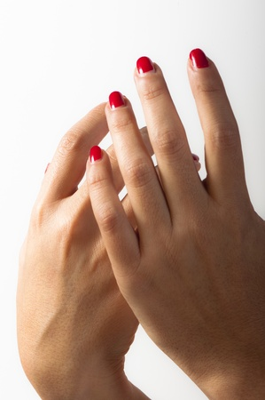 Hand of a young woman with her nails colored in red Stock Photo