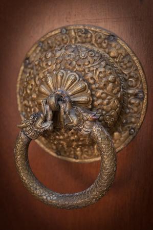 Ancient door knocker snake