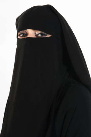 Portrait of a middle eastern beautiful woman wearing a black hijab