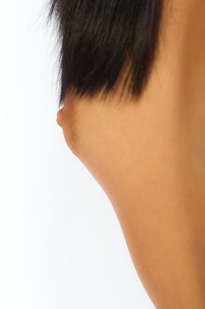 Closeup of female breasts over white background