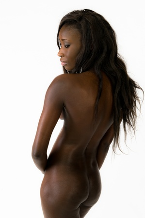 Beautiful young african woman sitting nude on withe