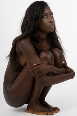 naked african: Beautiful young african woman sitting nude on withe