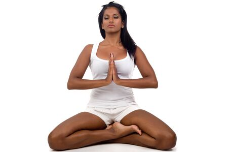Young Indian girl in lotus pose