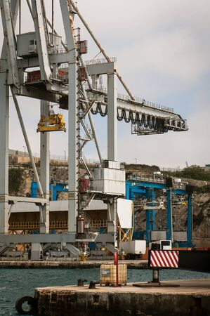 Cargo crane and ship in Malta Harbor