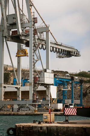 Cargo crane and ship in Malta Harbor