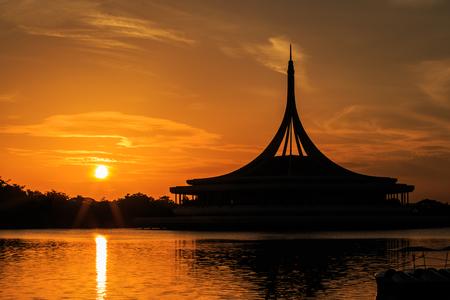 Silhouette shot of the iconic Ratchamongkol Pavillion at Rama 9 public park . The shot is taken at sunrise. photo
