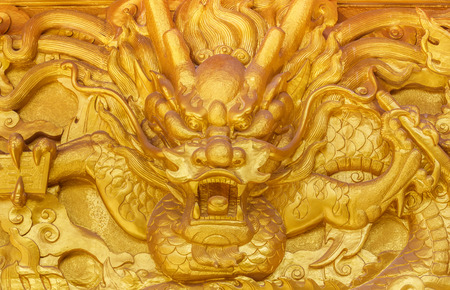 Chinese golden dragon wall at a public shrine photo