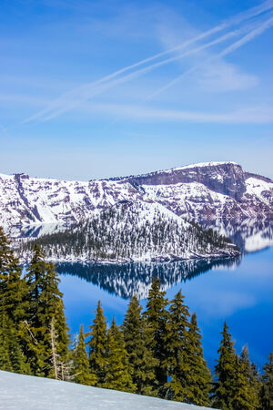 Beautiful crater lake with snow, oregon, USA photo