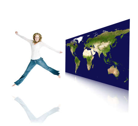 a girl jumping with joy in a room with a world map in the background photo