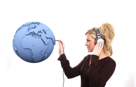 a girl is listening to the world photo
