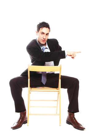 businessman is sitting and pointing to something photo