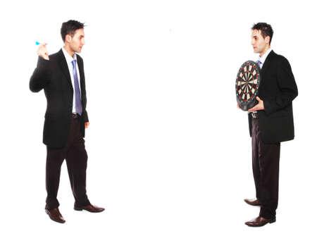 businessman throwing a dart to a dart board Фото со стока