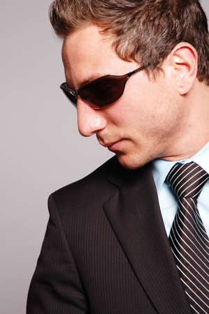 a businessman is posing against gray background Stock Photo - 2078933