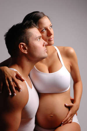 sexy pregnant: a pregnant woman and a man make a beautiful couple