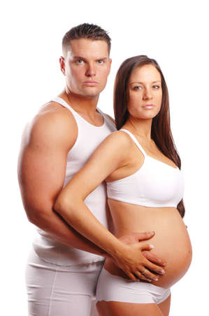man holding pregnant womans stomach