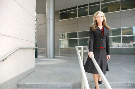 business woman is outside of business buildings Фото со стока
