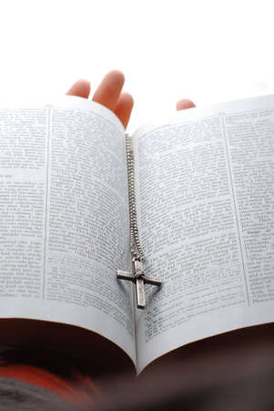 holy bible open with a cross on a hand Stock Photo - 2197653