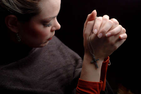 a woman is praying to god with hope Stok Fotoğraf