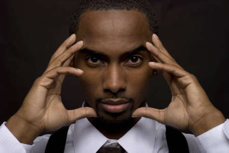 African American businessman is thinking intensely photo
