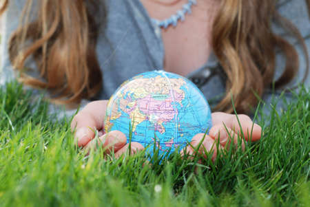 earth is being held by a little girls hands(shows asia)