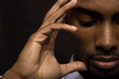 upset man: African American businessman is thinking intensely