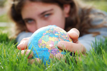 earth is being held by a little girls hands(shows europe) Stock Photo