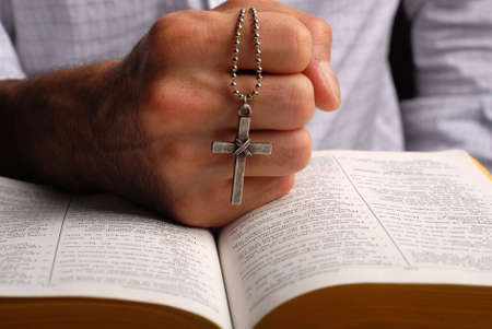 holy bible open with a cross on a hand Stock Photo - 2504406