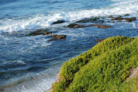 beautiful landscape with blue waves crashing to the shore