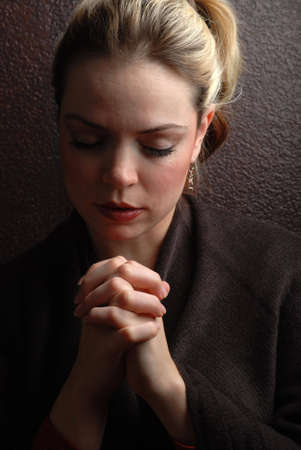 gods: a woman is praying to god with hope Stock Photo