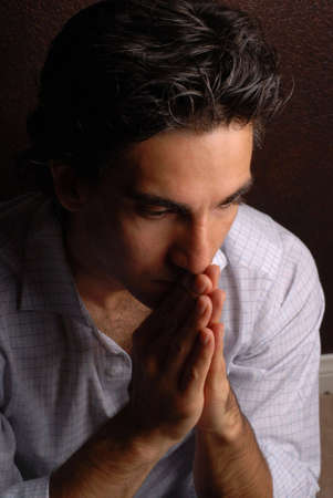 resolved: a sad man praying for his problems to be resolved