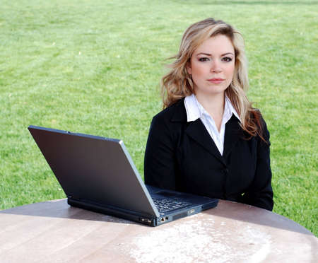 portrait of a confident and successful businesswoman with a laptop Фото со стока