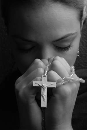 beautiful jesus: a woman is praying to god with hope Stock Photo
