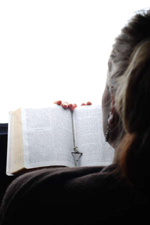 woman is reading the bible and praying photo