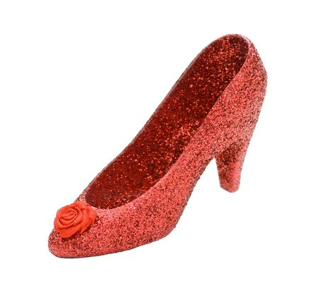 red glittery: There�s no place like home � A ruby red stiletto shoe, isolated