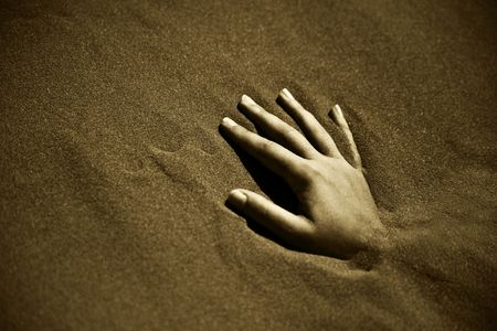 scorching: A womans hand buried in the Namibia desert sand Stock Photo