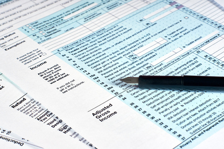 Tax reporting and pen. Filling out tax forms 免版税图像 - 116495813