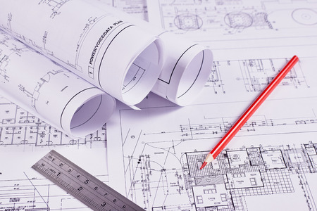 Engineering background. Construction drawings of buildings and structures next to ruler and red pencil. Close-up. Stock fotó