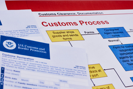 Page with the rules of customs process next to forms of the customs declaration Reklamní fotografie
