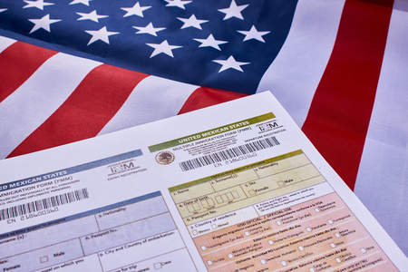Multiple immigration form United mexican states on American flag background.