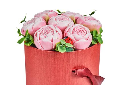 peonies from soap in a round red box, isolate on a white background